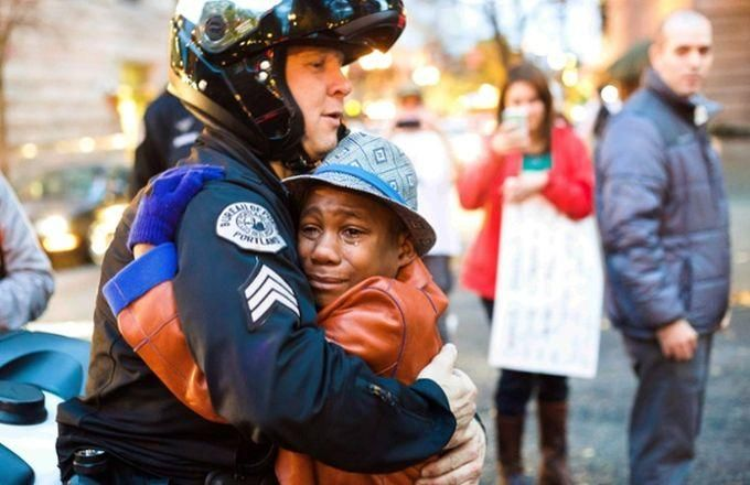 """The Famous """"Ferguson Hug"""" Photo Was Reportedly Staged"""