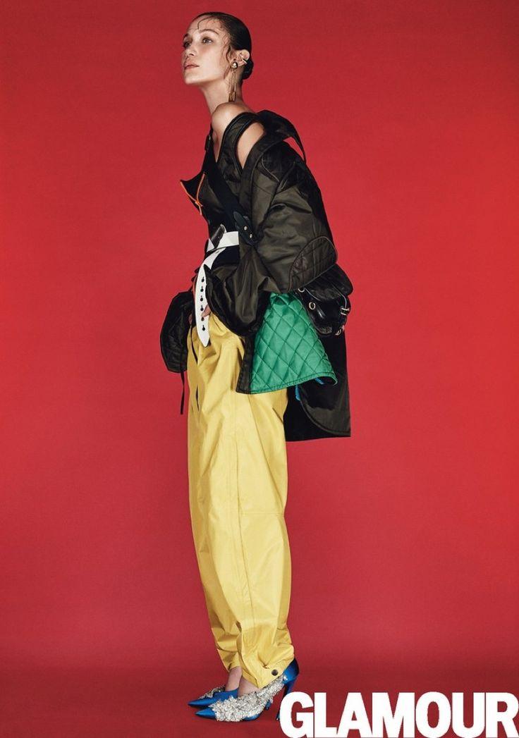Bella Hadid models Prada jacket, top, corset, belt and bag with Patagonia pants…