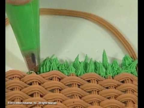 The grass decorating tip creates the most celebrated, easily accomplished decorations! The serrated edges of the grass tip makes ridges in the icing as you squeeze it out. Wilton's step-by-step video shows you how!