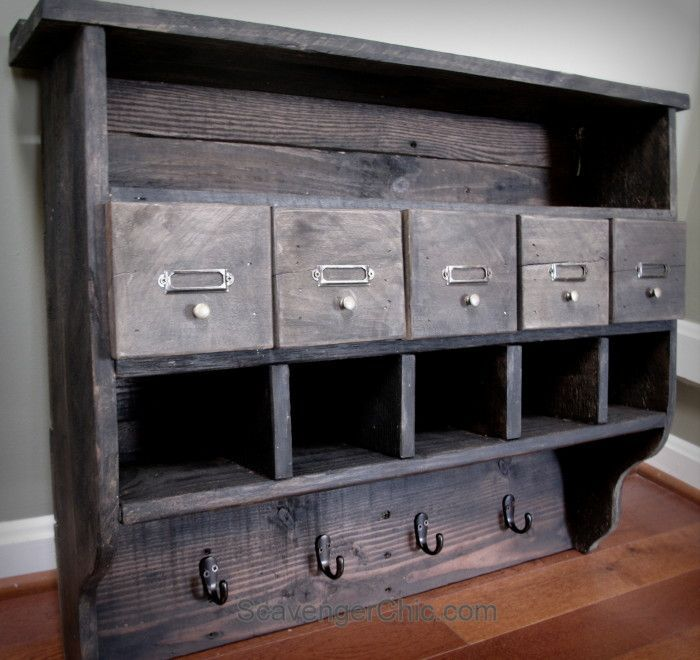how to make an awesome pallet wood cubby shelf for free using reclaimed pallet woood. You could even used reclaimed barnwood or fencing. http://MyRepurposedLife.com
