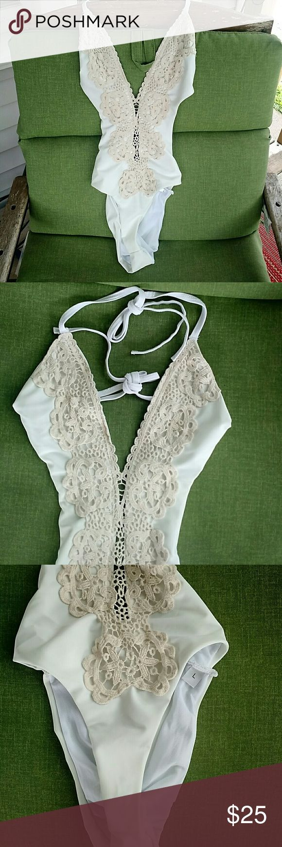 Super Sexy One piece- White Version. Cream one piece swim suit with crocheted accent. No padding. Ties around neck and back. Brand new! Never tried on or worn! Looks like medium. Not a big suit. Swim One Pieces