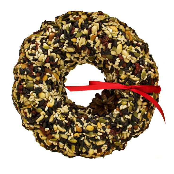 """WRTHX Merry Berry Seed Wreath This wreath is a solid seed, nut and fruit product that is held together with an edible, high protein, gelatin. Contains high kernel content sunflower, dried cranberries, pure white Canadian safflower and fresh roasted unsalted peanuts. 9""""x9""""x 1 1/2"""""""