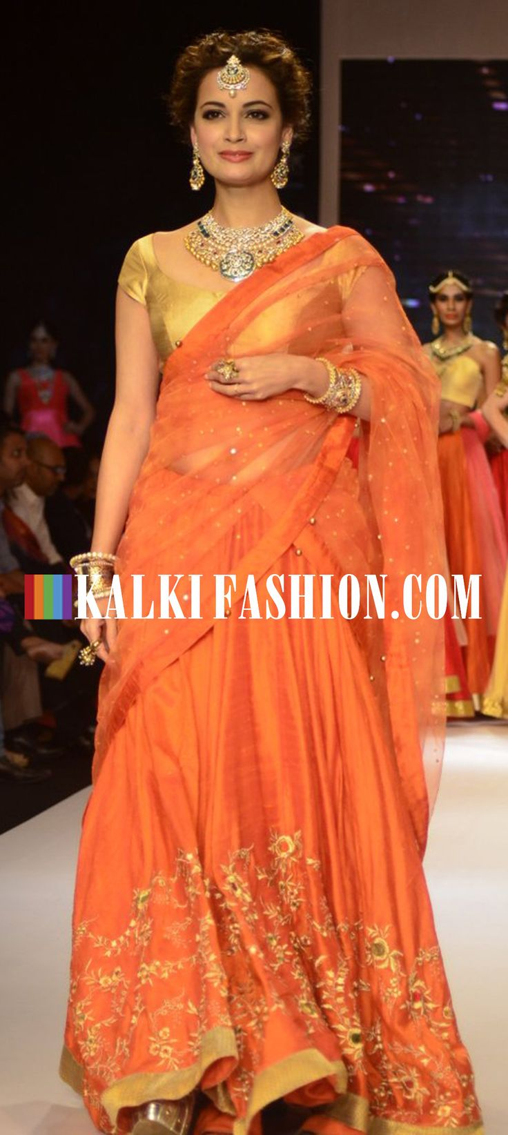 Dia Mirza walked the ramp in orange lehenga for Shobha Shringar at India International Jewellery week 2014. http://www.kalkifashion.com/