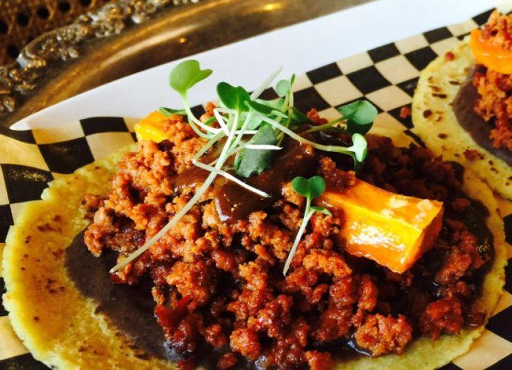 Zona Rosa's imaginative tacos include pork chorizo with mole negro, black bean puree, and sweet potatoes.
