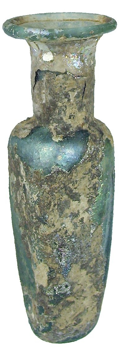 Roman glass :    Miniature light green glass bottle with a rectangular shaped body, indented base, rolled rim, some iridescence and encrustation.  50 - 100 AD