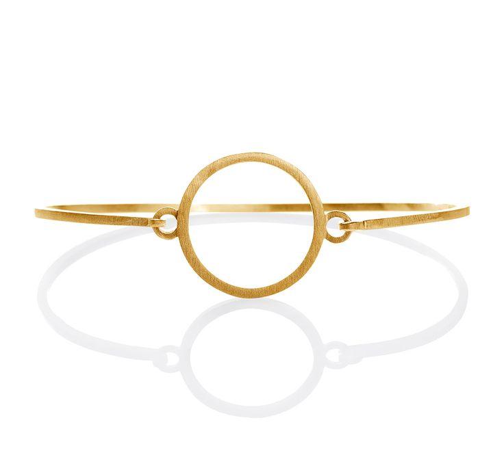 Anette Wille Cosmos armring er udført i 18 karat guld Serie: Cosmos af Anette Wille Materiale: Guld 18 K Dess.nr.: EA690-GOLD
