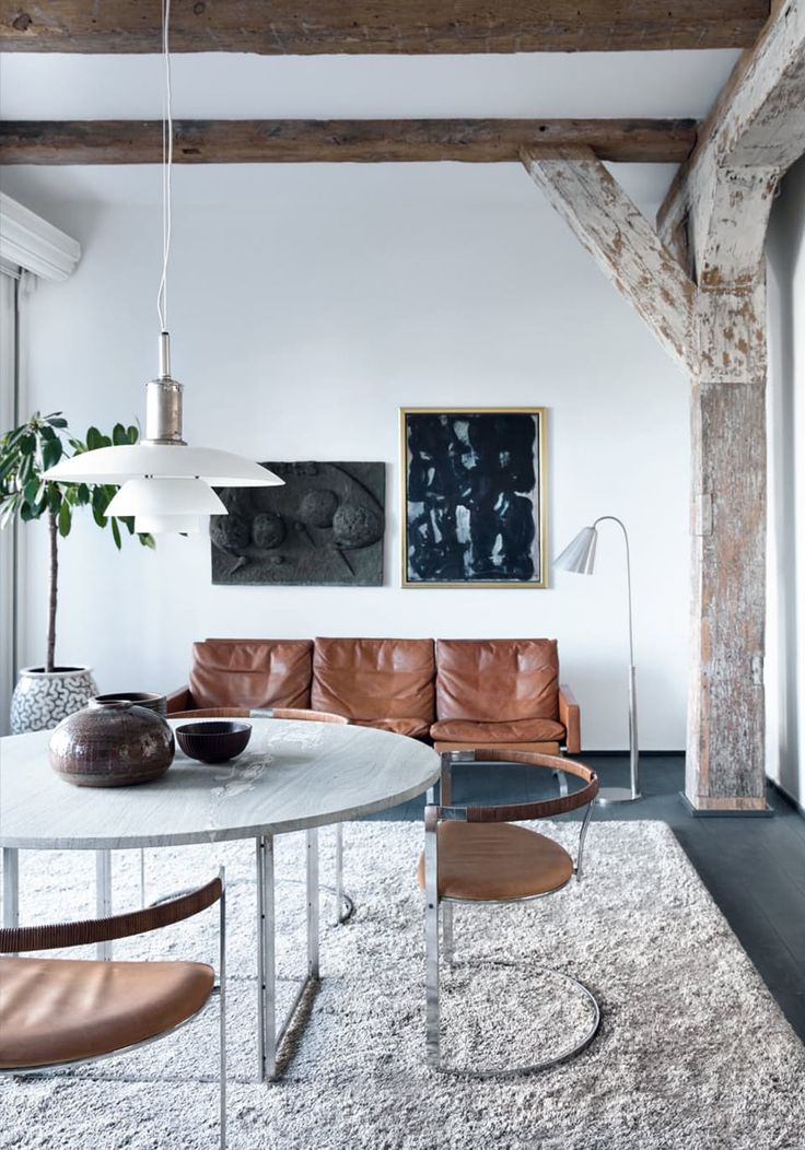 ROOM FILLED WITH DANISH DESIGN! Kold Christensen-produced Kjærholm PK54 dining table - four chairs designed by Fabricius & Kastholm - Kjærholm sofa, PK31, patinated cognac-coloured leather - nickel-plated Vilhelm Lauritzen floor lamp - an old PH lamp with canopy of metal and the shades of opal glass, named PH6 - painting by Mogens Andersen.