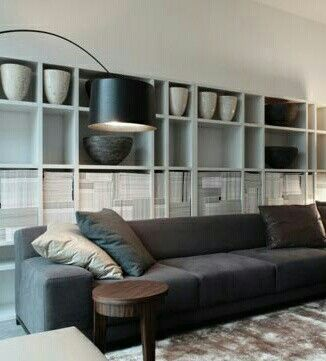 white wall shelving system with fabulous display - Ikea Expedit would achieve this with regular shaped niches instead