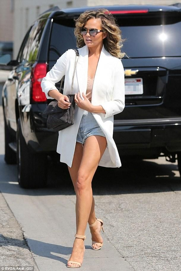 Chrissy Teigen wearing Lanvin Anthracite Suede Sugar Bag, Ksubi Hi & Hawt Short in Moonshine, Gianvito Rossi Portofino Sandals in Nude, The Row Russo Blazer and Cami NYC Race Silk Cami in Camel