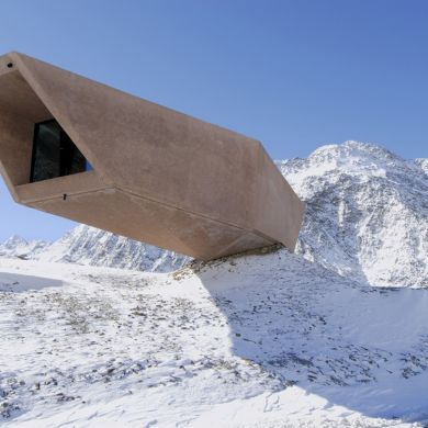 The Timmelsjoch Experience Pass Museum: Location: Brenner Pass, Italy Year of Construction: 2010 Architects: Werner Tscholl Architects  Shifted and set into the hillside, this dynamic building has a strong presence in the surrounding context.