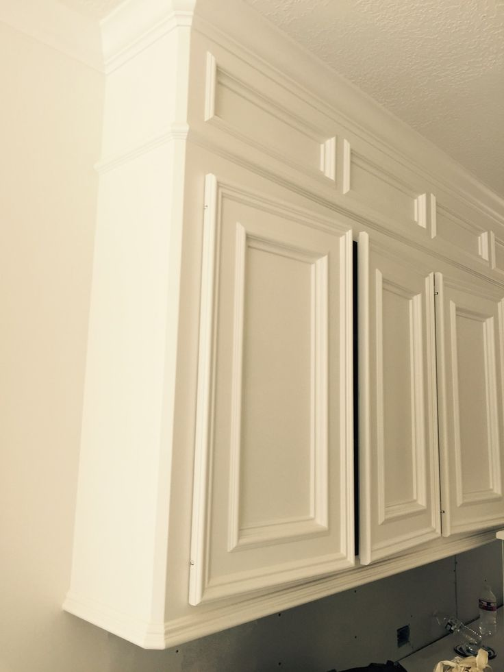 Painted kitchen cabinets with new paneled box above  Interior Designer: Carla Aston