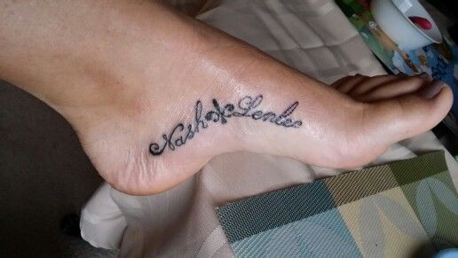 Inside foot arch tattoo of my children's names! Mine were born in LA so I added the fleur de lis