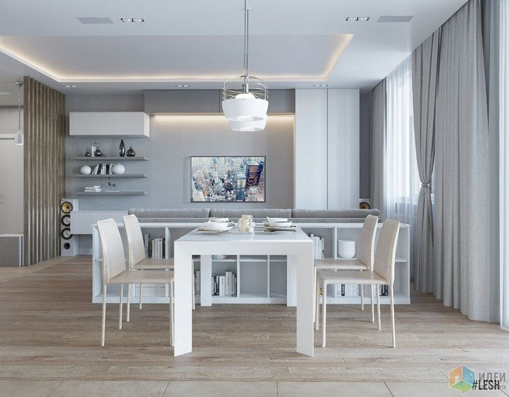 Зону гостиной от столовой условно разделяют комфортный угловой диван и небольшой стеллаж, к которому примыкает обеденный стол. Так как это опенспейс, из обеденной зоны хорошо просматривается телевизор.