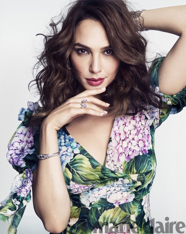 Actress Gal Gadot wears Dolce & Gabbana dress, Tiffany & Co. bracelets and Van Cleef & Arpels ring