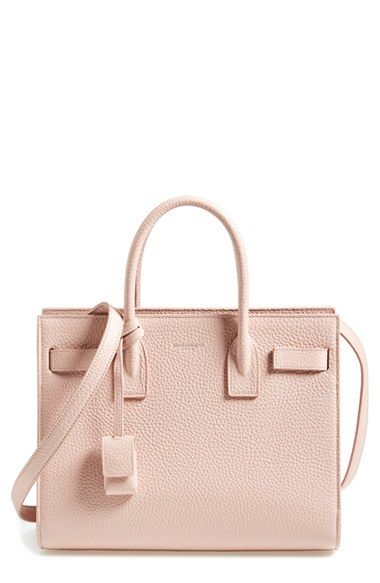 Free shipping and returns on Saint Laurent 'Baby Sac de Jour' Grained Calfskin Leather Tote at Nordstrom.com. Lavish grained calfskin enriches a sized-down version of a signature tote designed with compression snap-straps cinching the accordion sides. Sleek rolled handles and an embossed logo are the perfect finishing touches.