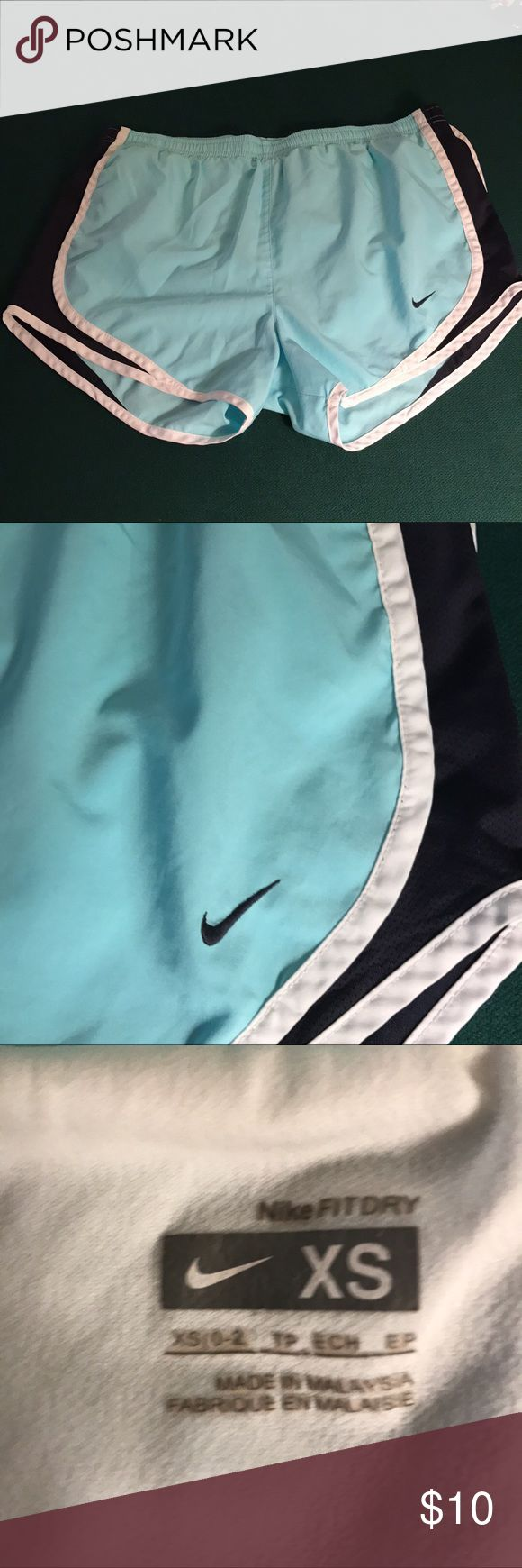Nike womens running shorts. Light blue Nike women's running shorts. Light blue with dark blue strip. Great condition! Nike Other