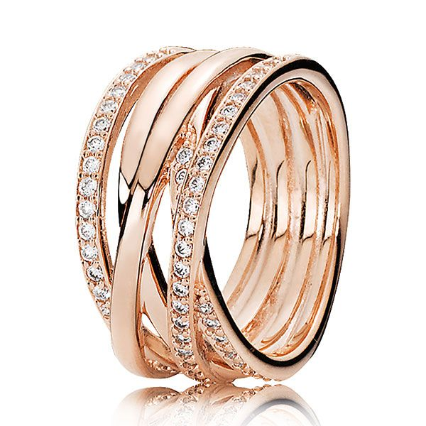 The entwined strands of lovely pink metal, with twinkling cubic zirconia stone details, form a modern statement ring that will upgrade any outfit.<br><br><i>Luminous and elegant, PANDORA Rose™ jewelry combines a unique blend of metals to capture new and unforgettable moments in warm pink-hues.</i><br> <br> <b> Style: </b> 180919CZ