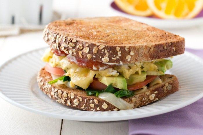 cheese, herbed scrambled eggs, avo, lettuce, tomato, cream cheese ...