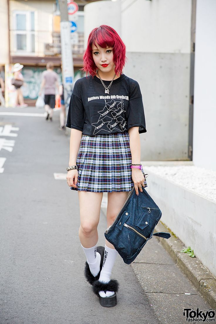Meet Coco, an Elle Girl blogger and VlliVlli Harajuku staffer with cure fuchsia hair. Coco's wearing a t-shirt from Barrack Room with a plaid American Apparel skirt, and a denim clutch from Labrat. Her furry platform sandals are from Bubbles Harajuku, her socks are Labrat, and her ring is Justin Davis. She is also wearing Vargas lipstick earrings, lock and cross necklaces, studded bracelets, and a purple watch. (Tokyo Fashion, 2014)
