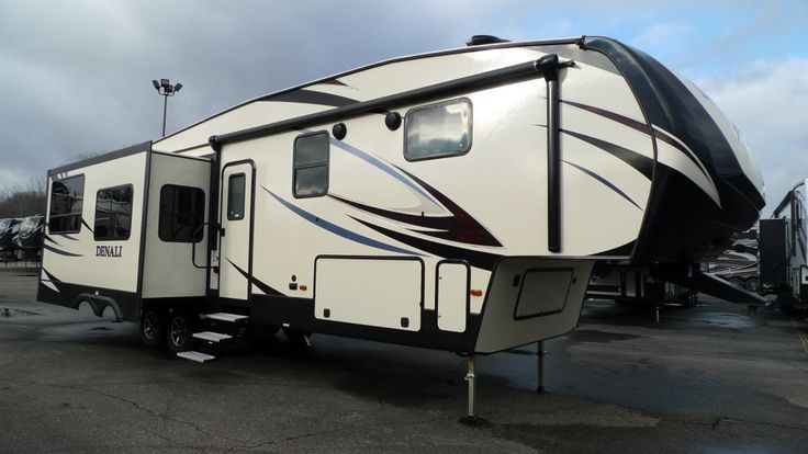 """WIDE OPEN SPACES INSIDE THE RV AND OUT!  2017 Dutchmen Denali 293RKS With beautiful barreled ceilings, a sprawling memory foam sofa, and a massive peninsular-style countertop, this 37' 11"""" long, 10024 lb RV is perfect for hosting dinner parties and entertaining guests! The open floor concept is complete with solid surface countertops, a mosaic backsplash, and a TV! Give our Denali expert Norman Wells a call 231-730-3481 for pricing and more information."""