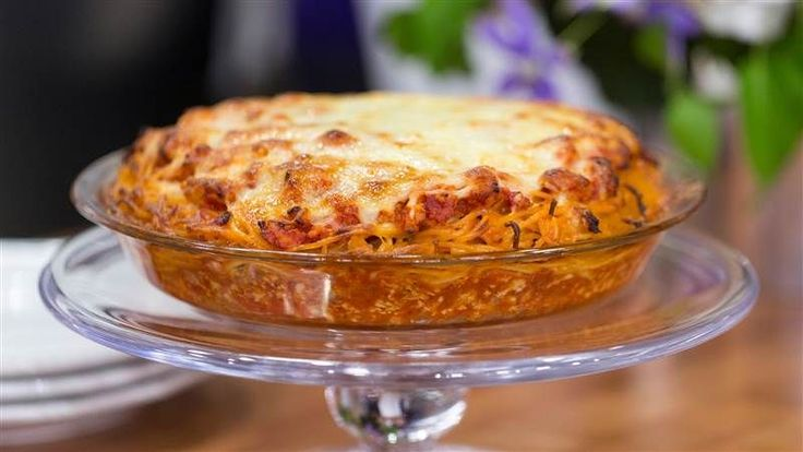 Adam Richman's recipe for spaghetti pie - I've done a spaghetti pie bake that my family raved about, I'll have to try this and see what kind of reactions we get!