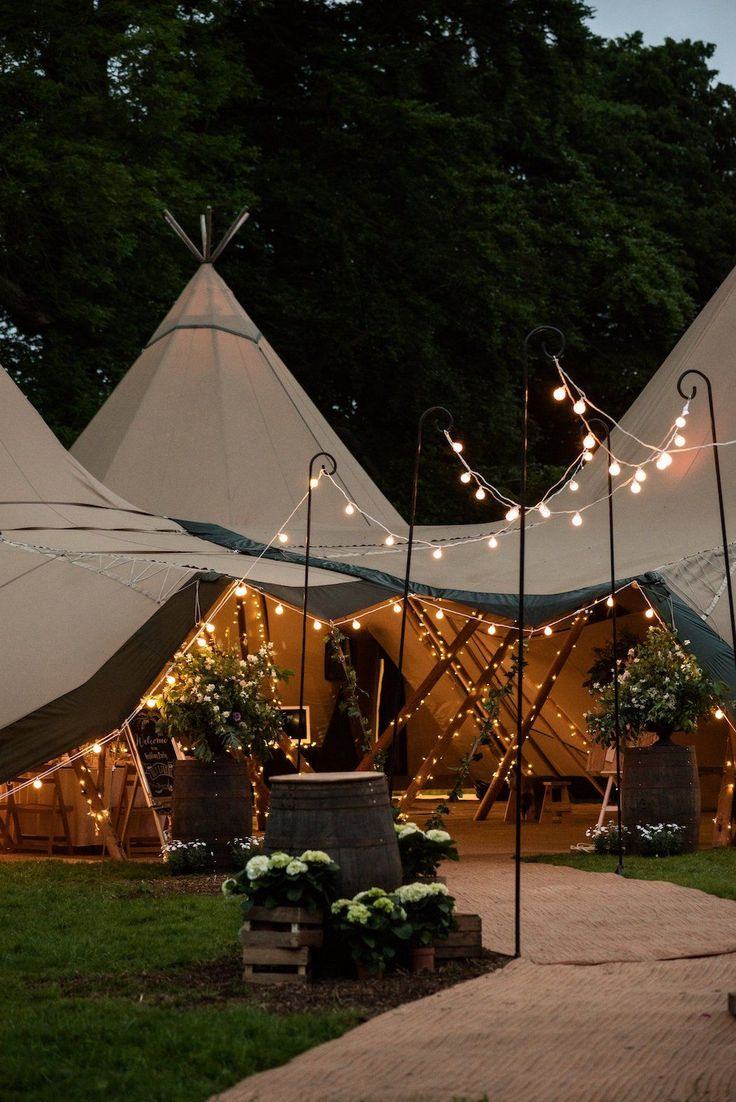 Tipis by night - festoon walkway. Inspiration for your tipi wedding Image by Sarah Vivienne Photography
