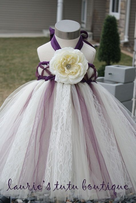 3-5 years $62.50  An ivory tutu dress with an egglant criss cross bodice and accents of eggplant, charcoal glimmer tulle, and ivory lace in the skirt. Finished with eggplant satin ribbon and a beautiful ivory flower with rhinestone center.    lauriestutuboutique.com