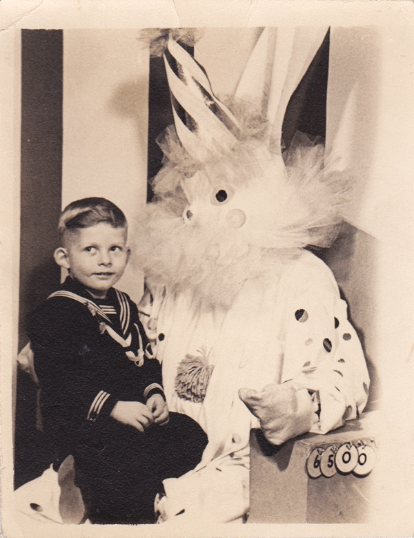 Navy Sailor On Leave sits on the Easter Bunnies Lap But the Easter Bunny is a CLOWN