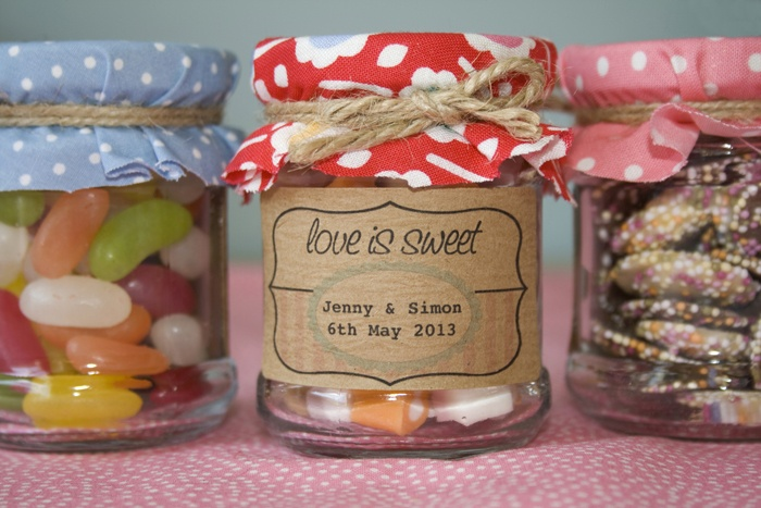 Wedding favours, sweets in jars with personalised stickers ..... I love this!