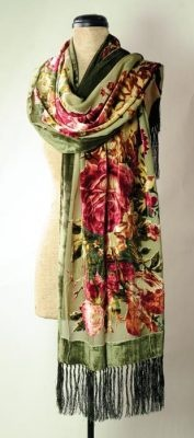 Silk Velvet Roses Scarf A breathtaking expanse of silk velvet is emblazoned with plump roses in antique hues of claret and moss. A generous width provides as a shawl for chilled shoulders, or draped at the neck.