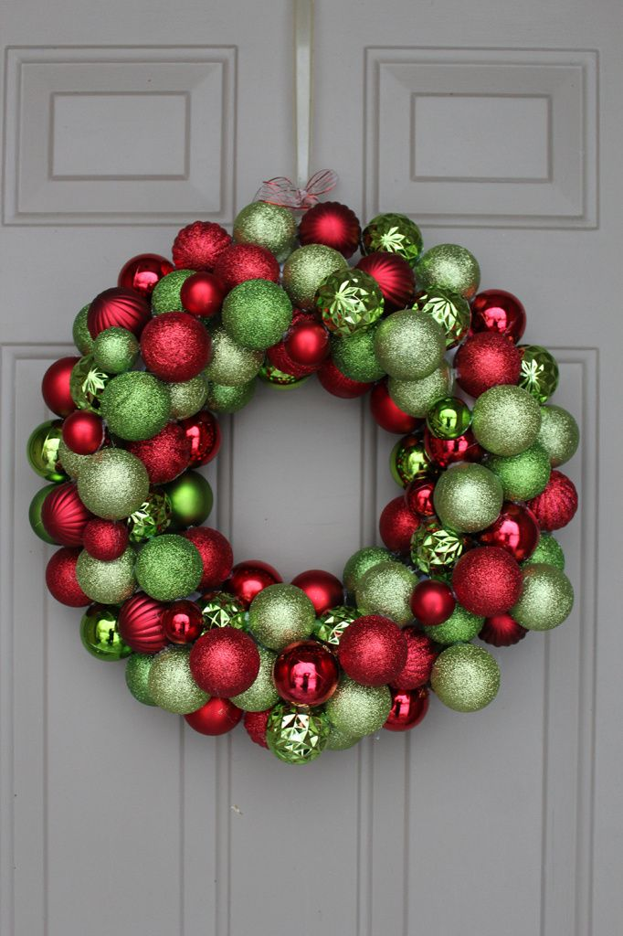 With only one week till Christmas, I wanted to share how to make a DIY ornament wreath to bring colour...