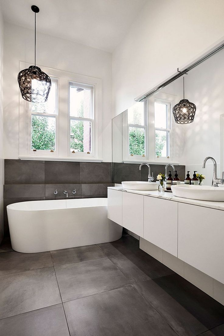 Fabulous bathroom design with pendant lighting and standalone bathtub