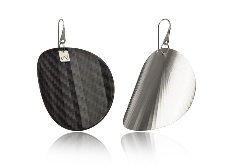 CARBON-CIRCLE-RHODIUM  Materials used: Hanger: 925 STERLING silver with rhodium flashing.   Front part: lacquered, high gloss carbon fiber, UV-resistant.   Back part:  satin effect metal surface, rhodium coating (platinum flashing) in 3 layers.   Gloss preserving, wear-proof, oxidation resistant and anti-allergenic.  Available in three sizes: with a diameter of 4, 5 and 6 cms.