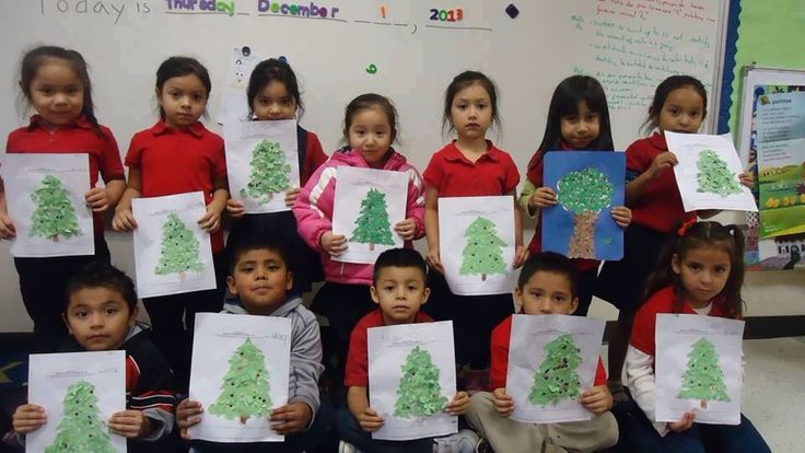 Notice the little sister second from the right top row, she was asked in her class at school to draw a tree. The rest of the children drew a Christmas tress, she drew an apple tree! <3