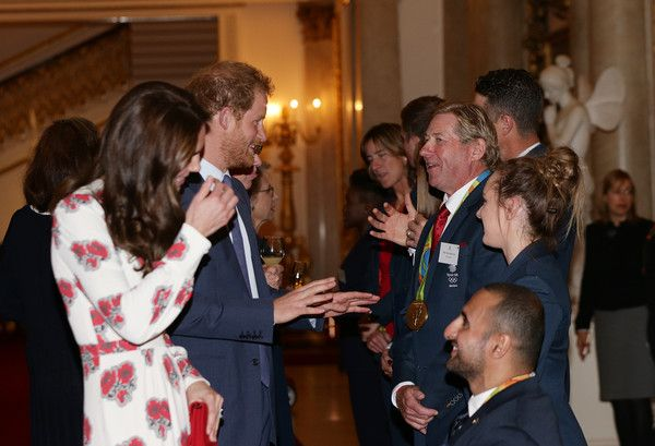 Prince Harry Photos Photos - Catherine, Duchess of Cambridge and Prince Harry meet Nick Skelton and athletes at a reception for Team GB's 2016 Olympic and Paralympic teams hosted by Queen Elizabeth II at Buckingham Palace October 18, 2016 in London, England. - Olympics