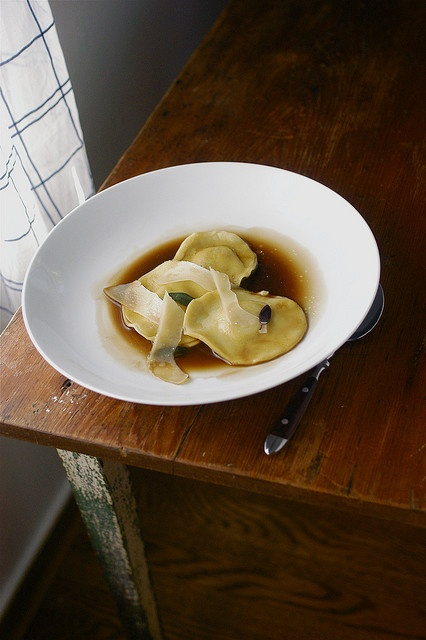 smoked duck ravioli with duck jus reduction