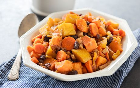 Tzimmes is a traditional sweet-and-savory Passover dish featuring dried fruit, sweet potatoes and carrots. We've added butternut squash for more veggie power and cooked everything in a slow cooker to make it convenient for entertaining.