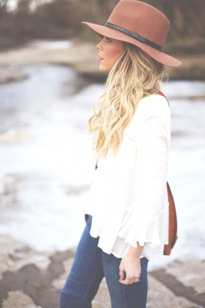 white flowy blouse + hat.