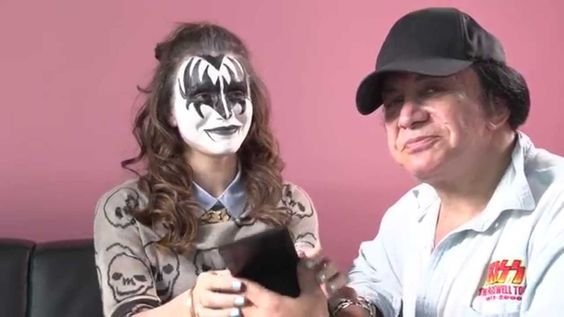 """In a video by Cosmopolitan, KISS co-frontman Gene Simmons demonstrates how to put on his iconic """"Demon"""" makeup by applying it to his daughter, Sophie Tweed Simmons. If you want the real KISS face, ..."""