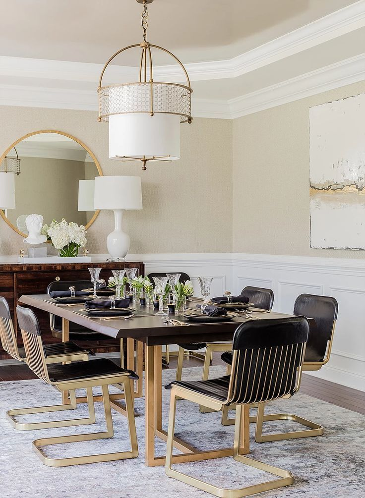 Round Gold Mirror Gold And Leather Dining Chairs White Wainscoting On Walls Shari Pellows Interi Mirror Dining Room Dining Room Design Rustic Dining Room