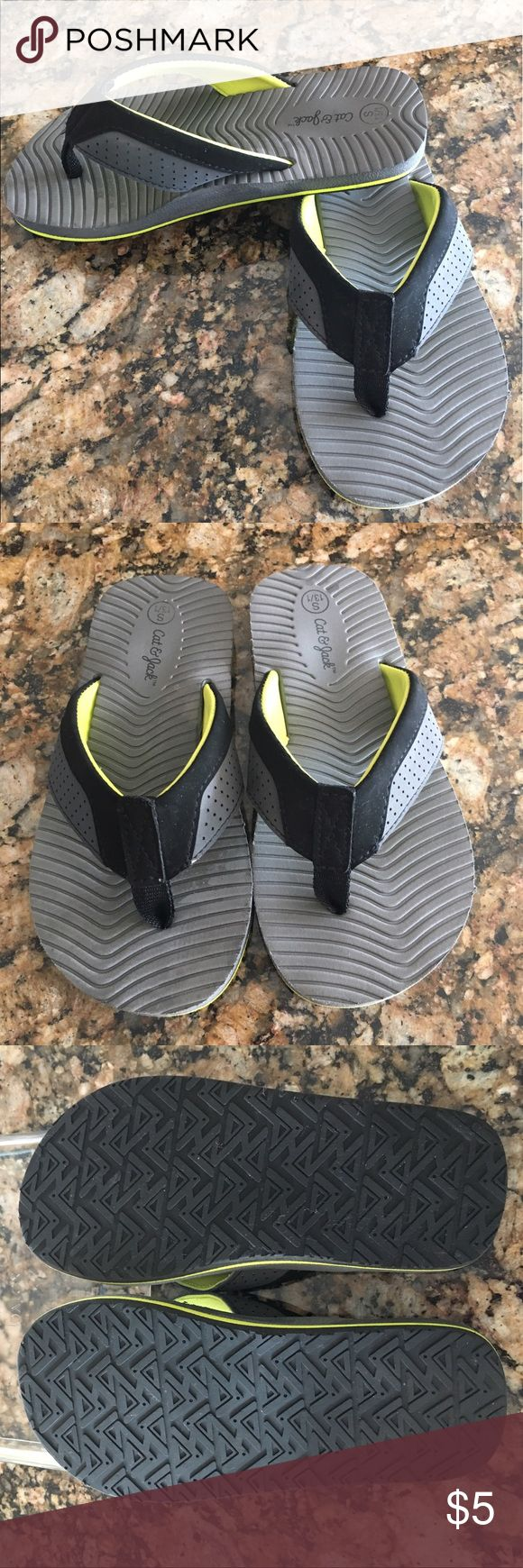 Like New!  Boys flip flop by Cat and Jack size S Like New!  Boys Flip Flops by Cat and Jack!  Gray, black with a touch of fluorescent yellow will go with just about anything.  Hardly worn as you can see from the pictures!  Lots of life left in these - lots of summer left! ☀️☀️☀️ cat and jack Shoes Sandals & Flip Flops