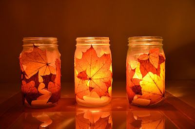 I just made these, and they are getting lots of comments! Each is just a Mason jar with a leaf stuck on and a candle inside. I added a burlap twine string around it, tied in a bow, to hold the leaf on, too. At night, the glow is really beautiful.