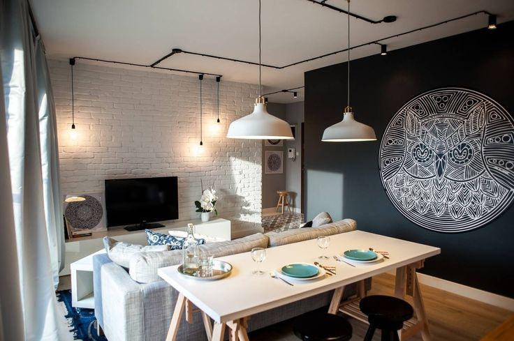 Salas de estar escandinavas por Raca Architekci