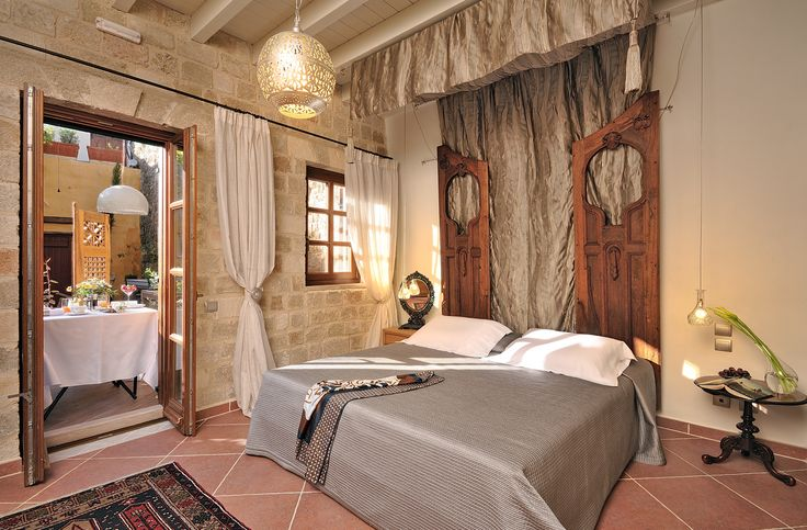 "EXCLUSIVE SUITES BOUTIQUE HOTEL. MEDIEVAL TOWN, RHODES, GREECE. - ""Orhan"" suite. The bedroom. Black oak door, ca 1930. - kokkiniporta.com"