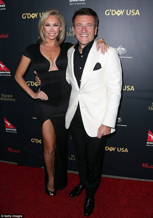 He popped the question! Robert Herjavec and Kym Johnson have confirmed their engagement, one year after meeting on ABC's Dancing With The Stars. They're pictured together last month in Los Angeles