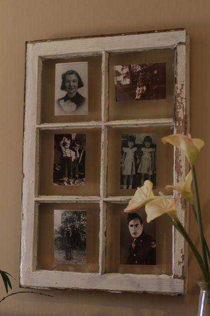 Repurposed vitaged window used as #picture frames.