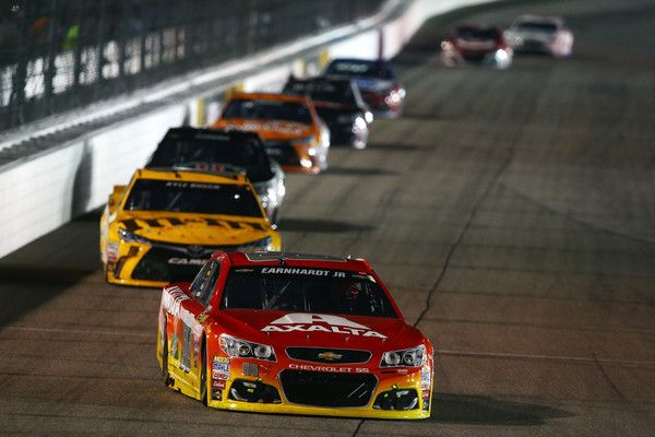 Jeff Gordon Photos Photos - Jeff Gordon, driver of the #88 Axalta Chevrolet, leads a pack of cars during the NASCAR Sprint Cup Series Federated Auto Parts 400 at Richmond International Raceway on September 10, 2016 in Richmond, Virginia. - NASCAR Sprint Cup Series Federated Auto Parts 400