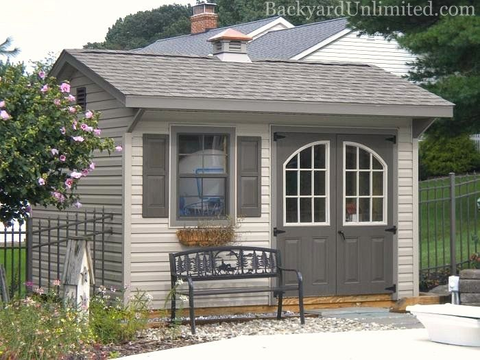 10x12 Quaker Garden Shed with Arched 9-Lite Wndows in Painted Fiberglass Doors, Gable Vent, Roll Ridge Vent, and Cupola