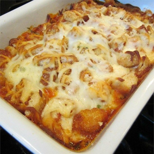 "The Best Parmesan Chicken Bake | ""This chicken Parmesan is done casserole style (so, no breading or frying!), but still offers up that irresistible combination of tender chicken, crunchy/cheesy coating, and flavorful sauce."""