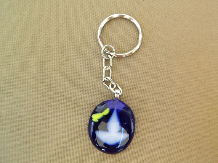 Fused glass blue key chain with a small boat